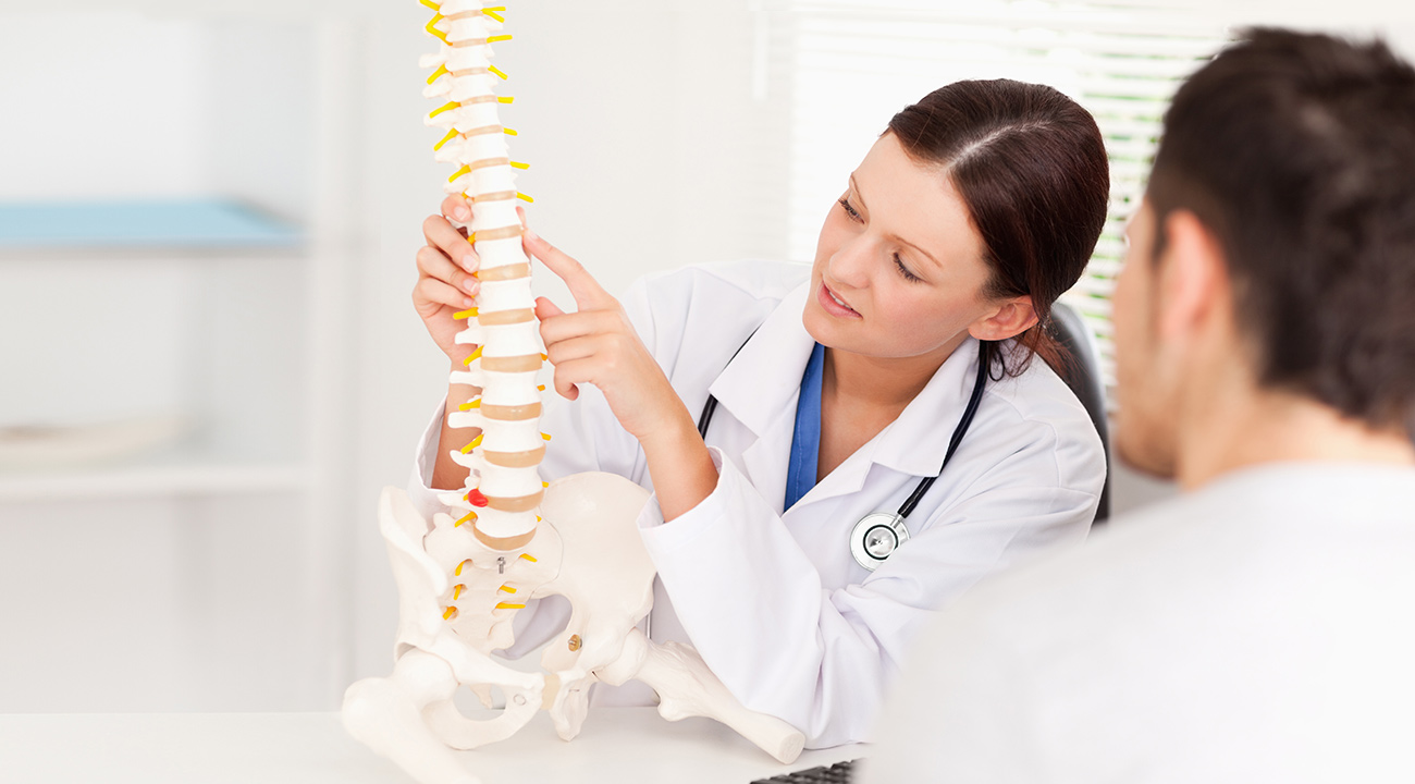 Female Chiropractor With Spine